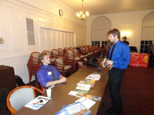 Membership Chair (Zachary Meehan) discusses graduate school programs of social work with an attendee